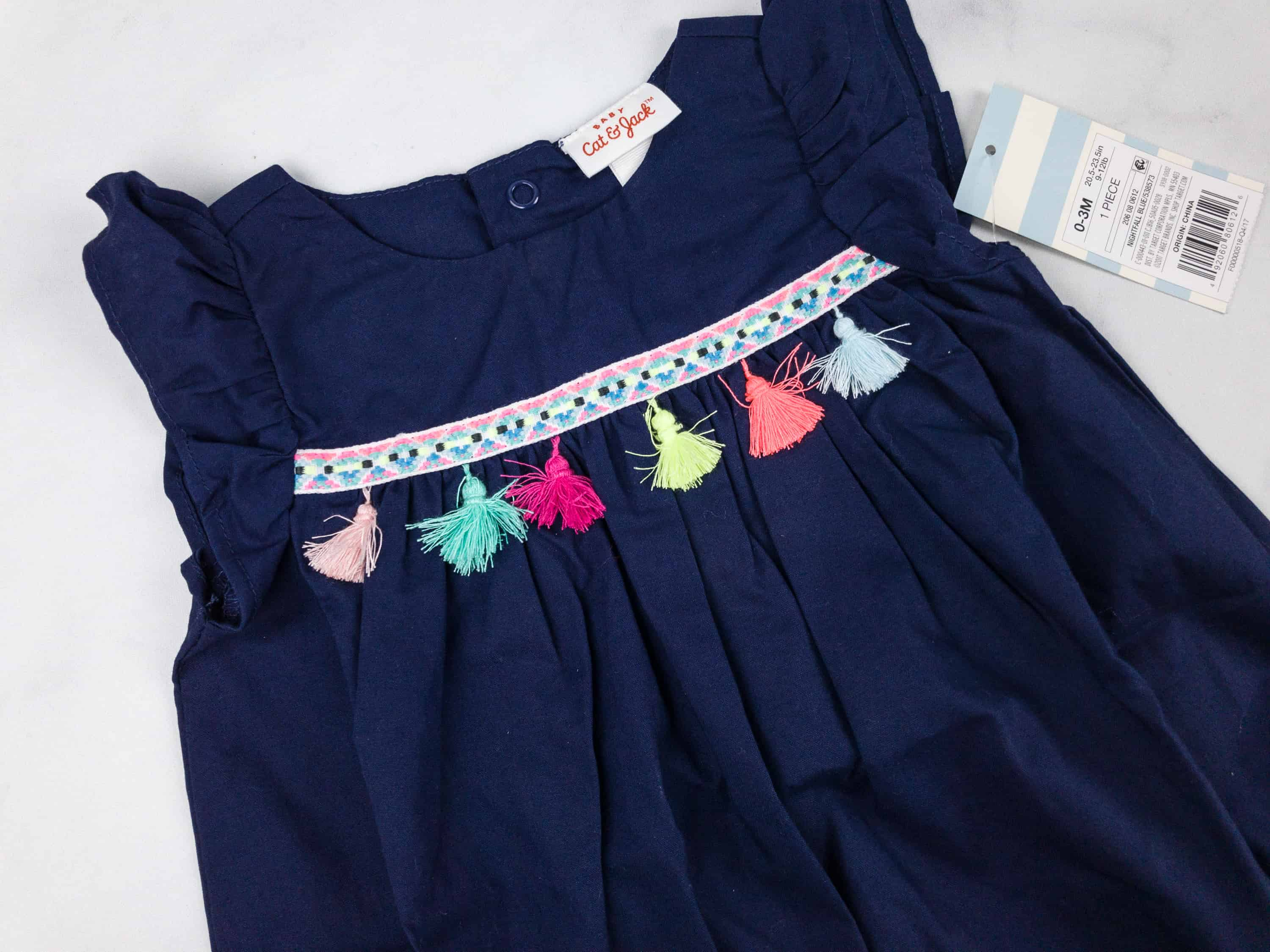 86edee68d1c1 This navy blue romper was decorated with tassels to make it look more fun  and colorful!