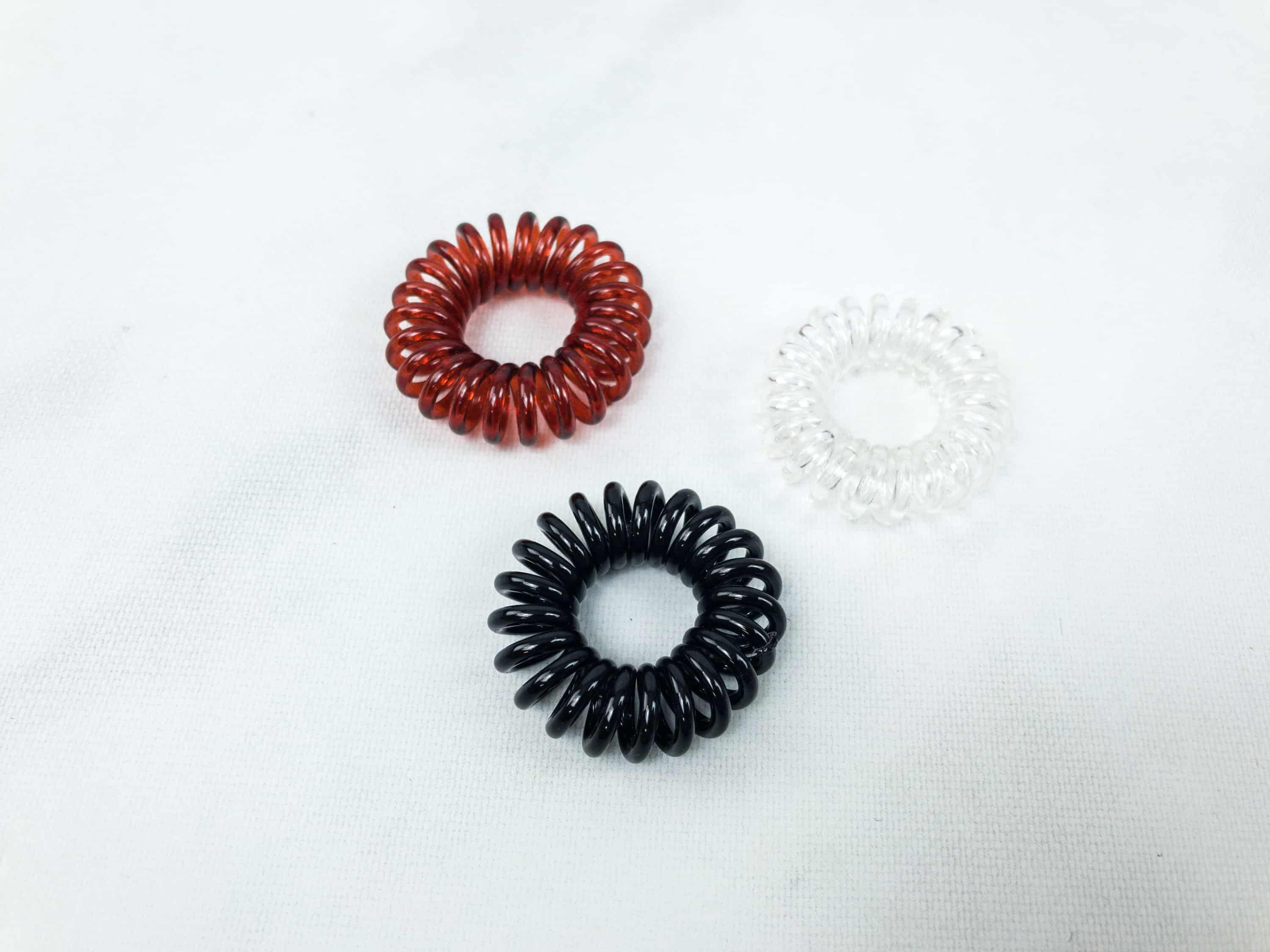 Some scrunchies or ponytails are heavy and too tight when used but this is  different. It doesn t drag the hair down acb6b82fc7a