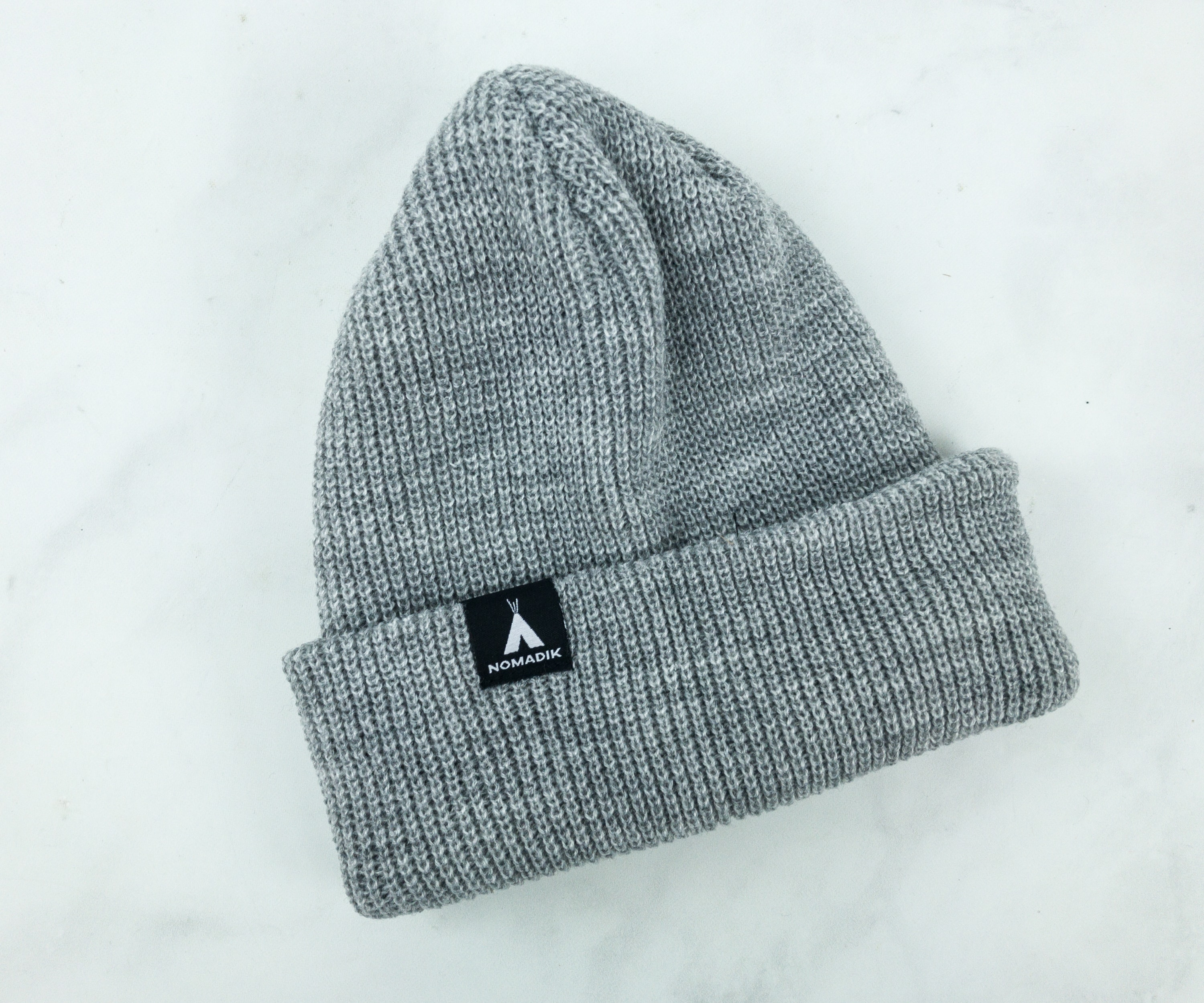 50d02d57923 There s a Nomadik logo on the beanie. You can fold the edges to keep it  snug on your head or give that extra flair by leaving the top a bit loose